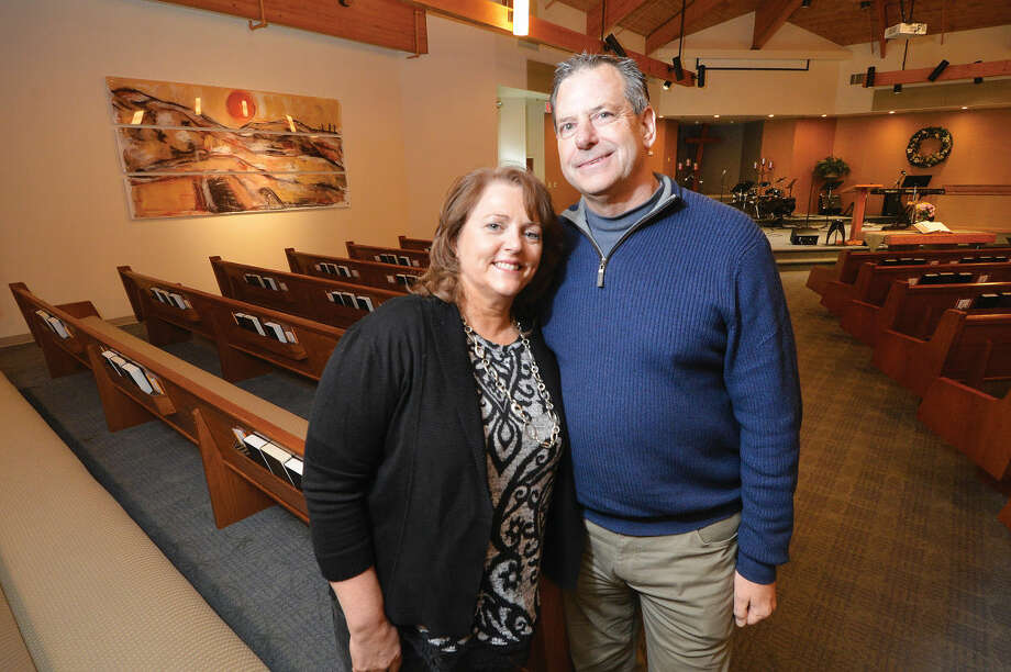 Author Jennifer Gish and her husband, Pastor Dave Gish, pose for a photo inside the sanctuary at Hope Church in Wilton.