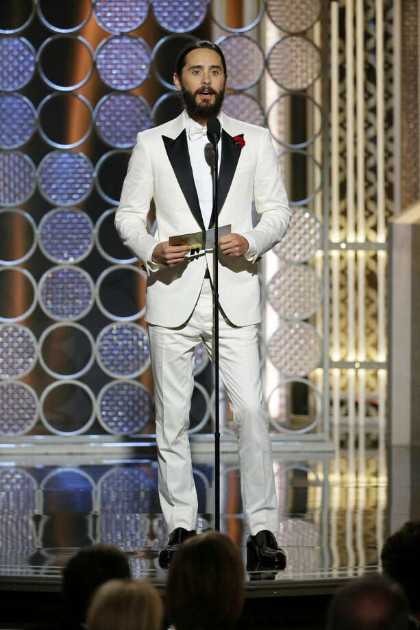 In this image released by NBC, Jared Leto presents an award at the 72nd Annual Golden Globe Awards on Sunday, Jan. 11, 2015, at the Beverly Hilton Hotel in Beverly Hills, Calif. (AP Photo/NBC, Paul Drinkwater)