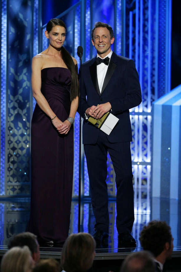 In this image released by NBC, Katie Holmes, left, and Seth Meyers present an award at the 72nd Annual Golden Globe Awards on Sunday, Jan. 11, 2015, at the Beverly Hilton Hotel in Beverly Hills, Calif. (AP Photo/NBC, Paul Drinkwater)