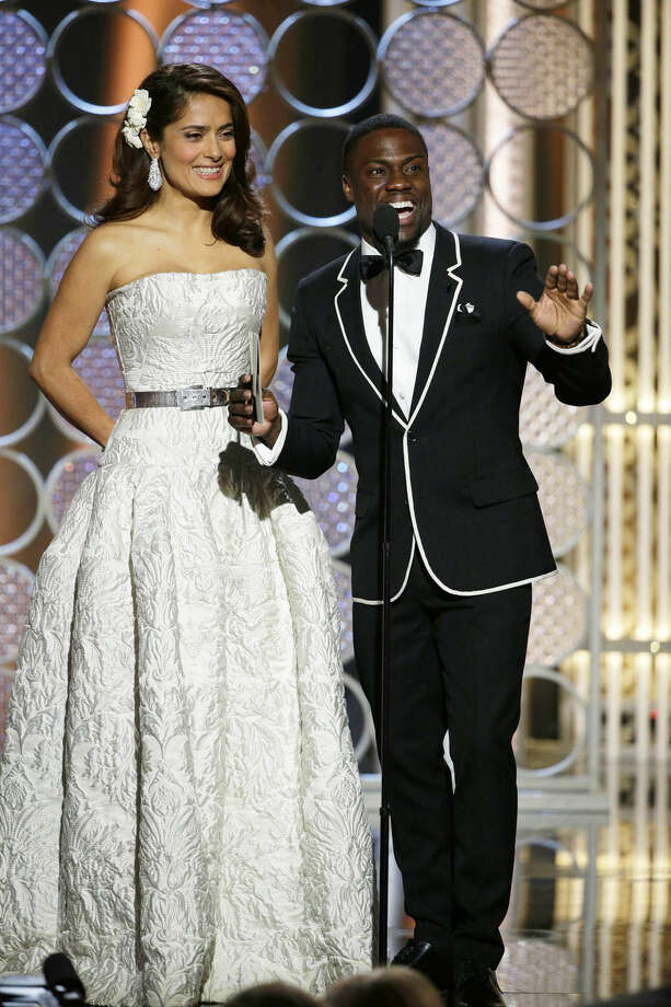 In this image released by NBC, Salma Hayek, left, and Kevin Hart present an award at the 72nd Annual Golden Globe Awards on Sunday, Jan. 11, 2015, at the Beverly Hilton Hotel in Beverly Hills, Calif. (AP Photo/NBC, Paul Drinkwater)