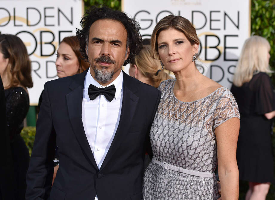 Alejandro Gonzalez Inarritu, left, and Maria Eladia Hagerman arrive at the 72nd annual Golden Globe Awards at the Beverly Hilton Hotel on Sunday, Jan. 11, 2015, in Beverly Hills, Calif. (Photo by John Shearer/Invision/AP)