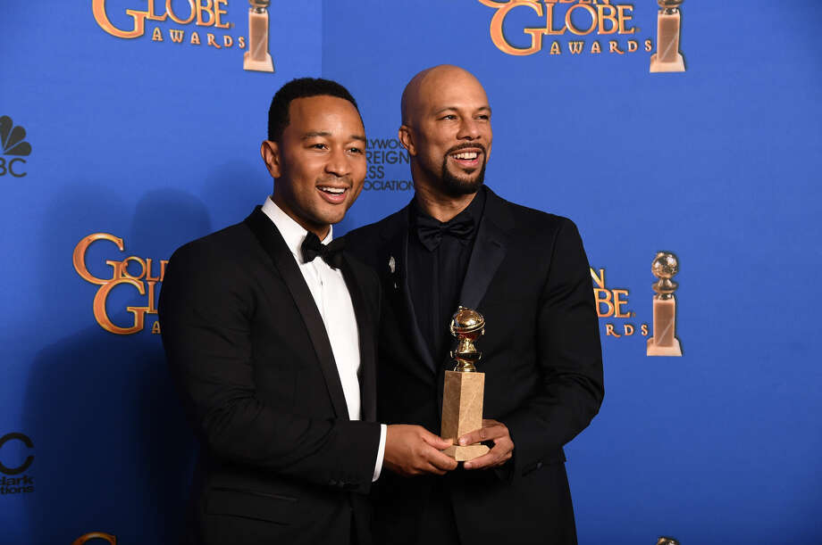 "John Legend, left, and Common pose in the press room with the award for best original song ""Glory"" in a film for ""Selma"" at the 72nd annual Golden Globe Awards at the Beverly Hilton Hotel on Sunday, Jan. 11, 2015, in Beverly Hills, Calif. (Photo by Jordan Strauss/Invision/AP)"