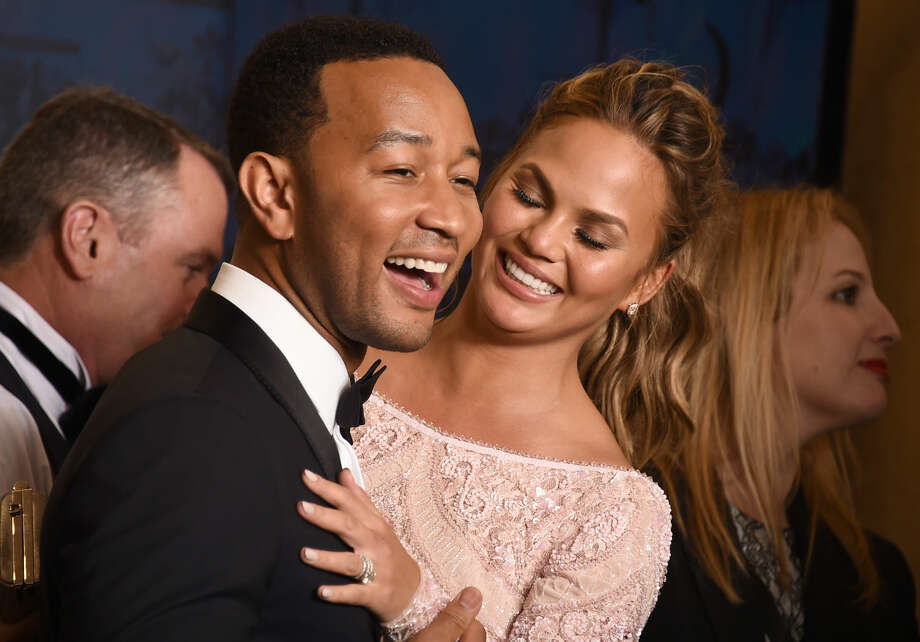 "John Legend, winner of the award for best original song ""Glory"" in a film for ""Selma"", poses with Chrissy Teigen, right, in the press room at the 72nd annual Golden Globe Awards at the Beverly Hilton Hotel on Sunday, Jan. 11, 2015, in Beverly Hills, Calif. (Photo by Jordan Strauss/Invision/AP)"
