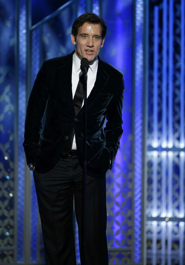 In this image released by NBC, Clive Owen speaks at the 72nd Annual Golden Globe Awards on Sunday, Jan. 11, 2015, at the Beverly Hilton Hotel in Beverly Hills, Calif. (AP Photo/NBC, Paul Drinkwater)