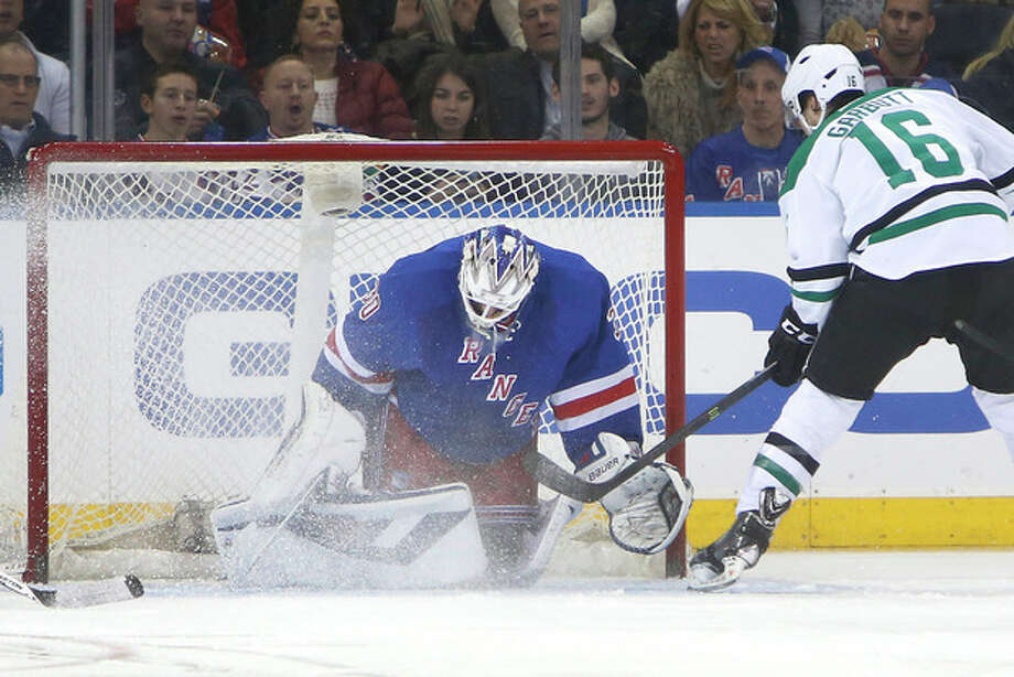 Dallas Stars' Ryan Garbutt (16) scores a goal against New York Rangers goalie Henrik Lundqvist (30), of Sweden, during the second period of an NHL hockey game, Friday, Jan. 10, 2014, in New York. (AP Photo/Jason DeCrow) / FR103966 AP