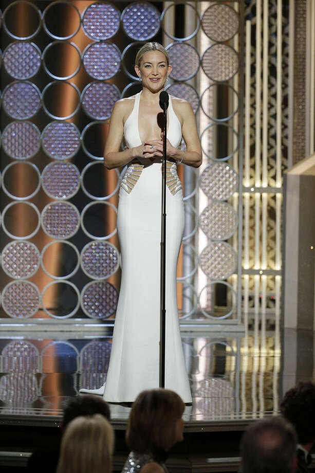 In this image released by NBC, Kate Hudson speaks at the 72nd Annual Golden Globe Awards on Sunday, Jan. 11, 2015, at the Beverly Hilton Hotel in Beverly Hills, Calif. (AP Photo/NBC, Paul Drinkwater)