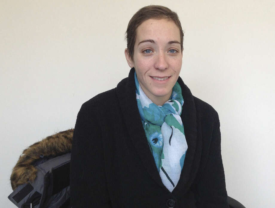 In this photo taken on Friday, 12, 2016, Brittany Barger, 27, who suffers from advanced ovarian cancer, poses for a photo at Vireo Health, a suburban medical marijuana dispensary in White Plains, N.Y. When medical marijuana became legal this month in New York, one of the strictest among the 23 states to legalize the drug for medical purposes, Barger was one of the first patients though the dispensaries' doors because her doctor was willing to take a state-required course to be able to certify her as a patient. (AP Photo/Jennifer Peltz)