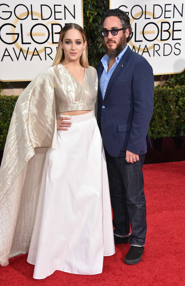 Jemima Kirke, left, and Michael Mosberg arrive at the 72nd annual Golden Globe Awards at the Beverly Hilton Hotel on Sunday, Jan. 11, 2015, in Beverly Hills, Calif. (Photo by John Shearer/Invision/AP)