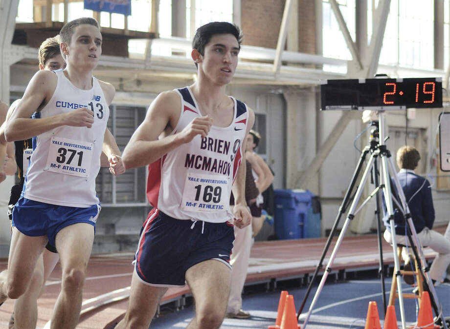 Hour photo/Mary AlblBrien McMahon's Eric van der Els competes in the 3,000-meter run at the Yale Track Classic on Saturday at Coxe Cage. Van der Els finished third overall in the event with apersonal-best and school-record time of 8:28.80.