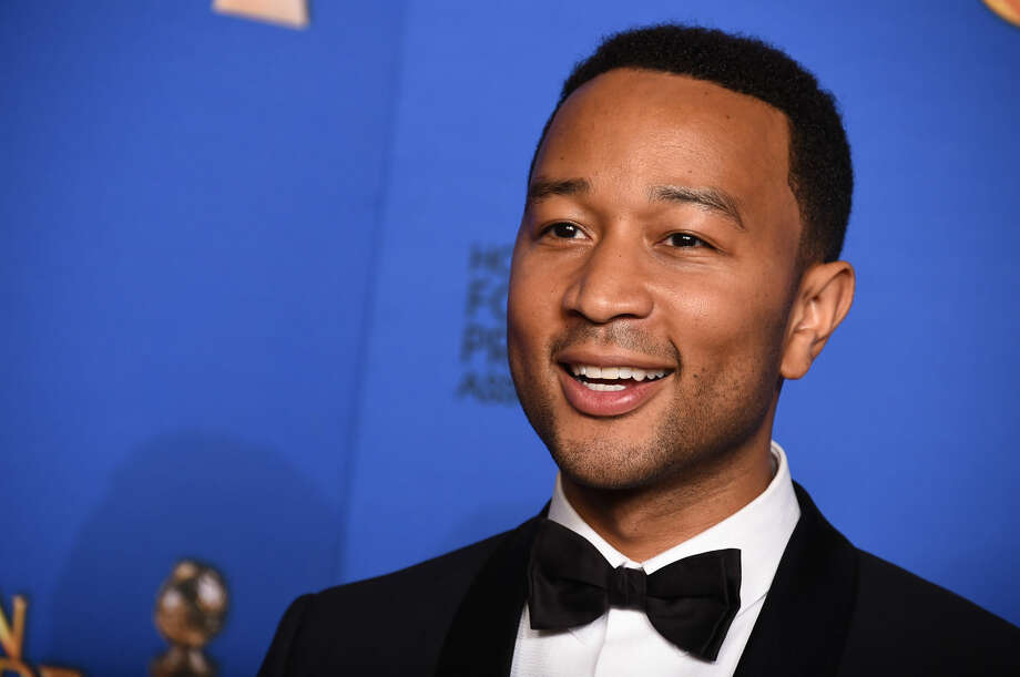 "John Legend poses in the press room after winning the award for best original song ""Glory"" in a film for ""Selma"" at the 72nd annual Golden Globe Awards at the Beverly Hilton Hotel on Sunday, Jan. 11, 2015, in Beverly Hills, Calif. (Photo by Jordan Strauss/Invision/AP)"