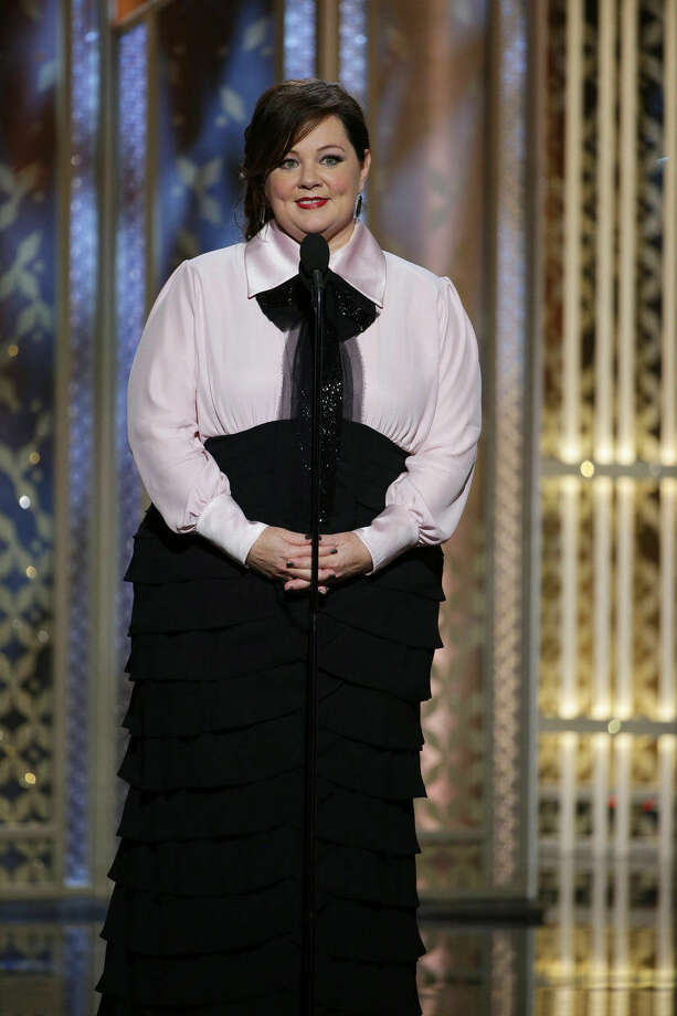 "In this image released by NBC, Melissa McCarthy presents the film ""St. Vincent"" at the 72nd Annual Golden Globe Awards on Sunday, Jan. 11, 2015, at the Beverly Hilton Hotel in Beverly Hills, Calif. (AP Photo/NBC, Paul Drinkwater)"