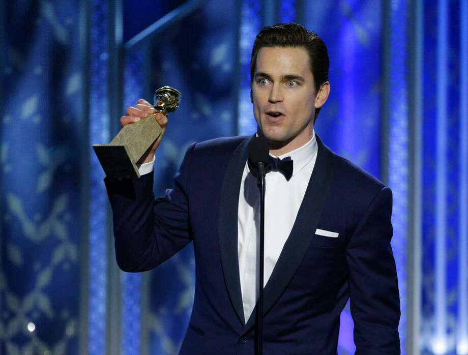 "In this image released by NBC, Matt Bomer accepts the award for best supporting actor in a series, mini-series or TV movie for his role in ""The Normal Heart"", at the 72nd Annual Golden Globe Awards on Sunday, Jan. 11, 2015, at the Beverly Hilton Hotel in Beverly Hills, Calif. (AP Photo/NBC, Paul Drinkwater)"