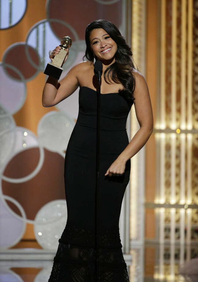 "In this image released by NBC, Gina Rodriguez poses with the award for best actress in a TV series, comedy or musical for her role in ""Jane the Virgin"" at the 72nd Annual Golden Globe Awards on Sunday, Jan. 11, 2015 at the Beverly Hilton Hotel in Beverly Hills, Calif. (AP Photo/NBC, Paul Drinkwater)"