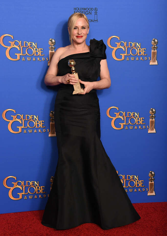 "Patricia Arquette poses in the press room with the award for best supporting actress in a motion picture for ""Boyhood"" at the 72nd annual Golden Globe Awards at the Beverly Hilton Hotel on Sunday, Jan. 11, 2015, in Beverly Hills, Calif. (Photo by Jordan Strauss/Invision/AP)"