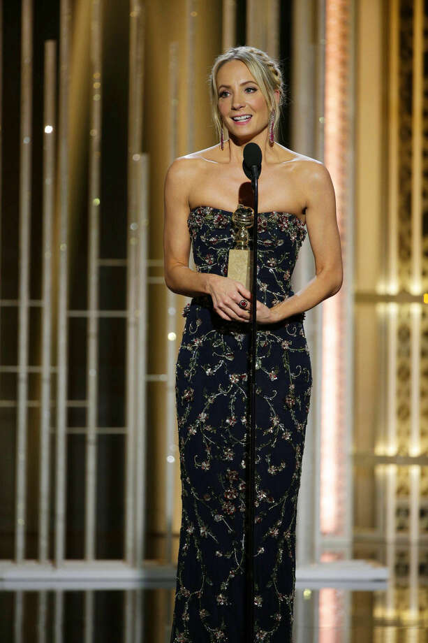 "In this image released by NBC, Joanne Froggatt accepts the award for best supporting actress in a series, mini-series or TV movie for her role in ""Downton Abbey"", at the 72nd Annual Golden Globe Awards on Sunday, Jan. 11, 2015, at the Beverly Hilton Hotel in Beverly Hills, Calif. (AP Photo/NBC, Paul Drinkwater)"