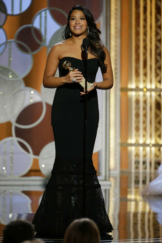 "In this image released by NBC, Gina Rodriguez accepts the award for best actress in a TV series, comedy or musical for her role in ""Jane the Virgin"" at the 72nd Annual Golden Globe Awards on Sunday, Jan. 11, 2015 at the Beverly Hilton Hotel in Beverly Hills, Calif. (AP Photo/NBC, Paul Drinkwater)"