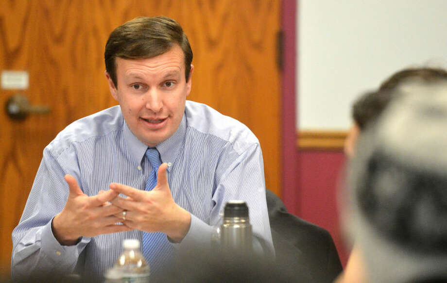 Hour Photo/Alex von Kleydorff U.S. Senator Chris Murphy speaks with students at NCC about the need to reduce the cost of a higher education