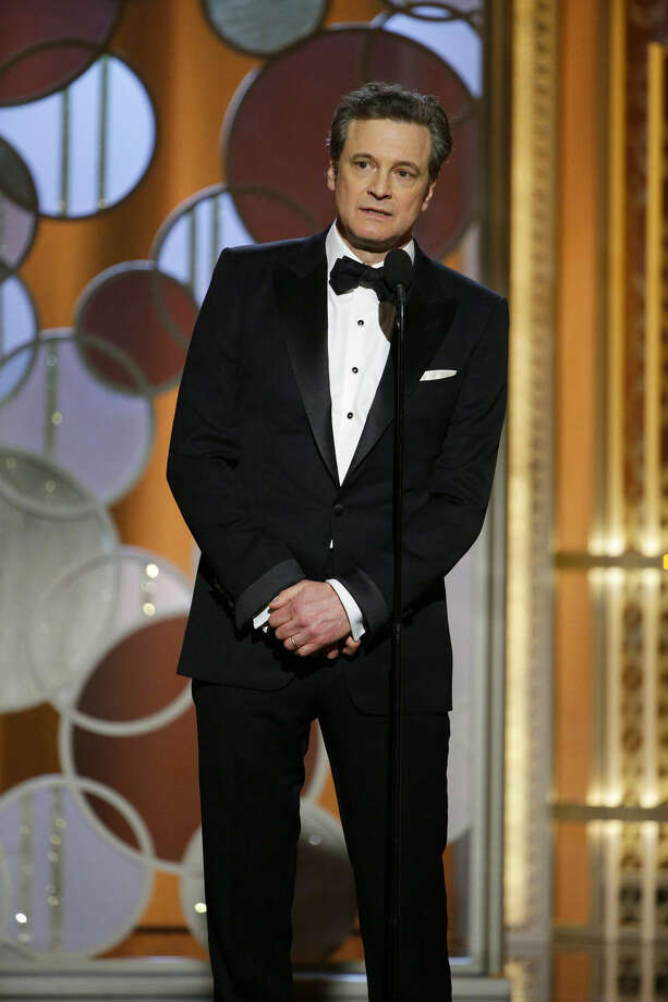 In this image released by NBC, Colin Firth presents an award at the 72nd Annual Golden Globe Awards on Sunday, Jan. 11, 2015 at the Beverly Hilton Hotel in Beverly Hills, Calif. (AP Photo/NBC, Paul Drinkwater)