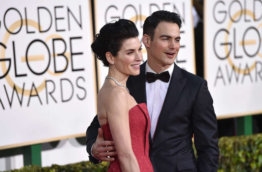 Julianna Margulies, left, and Keith Lieberthal arrive at the 72nd annual Golden Globe Awards at the Beverly Hilton Hotel on Sunday, Jan. 11, 2015, in Beverly Hills, Calif. (Photo by John Shearer/Invision/AP)