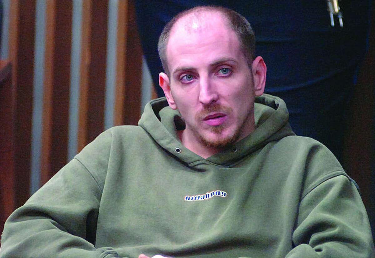 Hour Photo/ Alex von Kleydorff Justin Smith in Norwalk Superior Court Nov. 21, 2011.