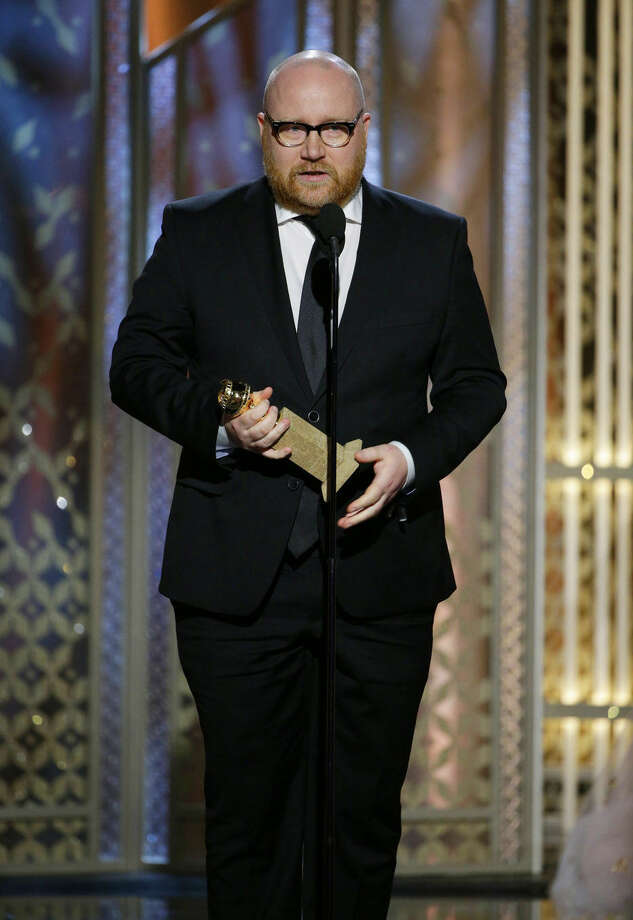 "In this image released by NBC, Johann Johannsson accepts the award for best original score for ""The Theory of Everything"" at the 72nd Annual Golden Globe Awards on Sunday, Jan. 11, 2015, at the Beverly Hilton Hotel in Beverly Hills, Calif. (AP Photo/NBC, Paul Drinkwater)"