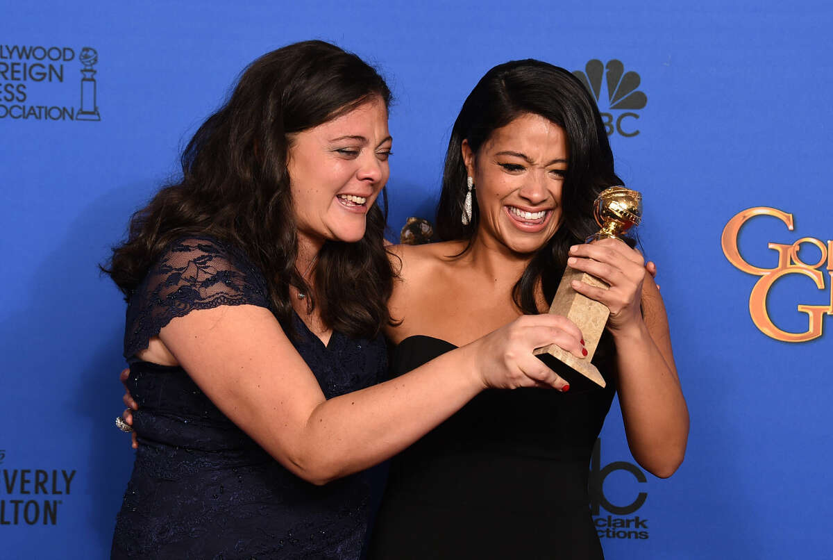 Evelise Rodriguez, left, and Gina Rodriguez pose in the press room with the award for best actress in a television series - musical or comedy for