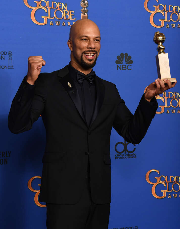 "Common poses in the press room with the award for best original song ""Glory"" in a film for ""Selma"" at the 72nd annual Golden Globe Awards at the Beverly Hilton Hotel on Sunday, Jan. 11, 2015, in Beverly Hills, Calif. (Photo by Jordan Strauss/Invision/AP)"