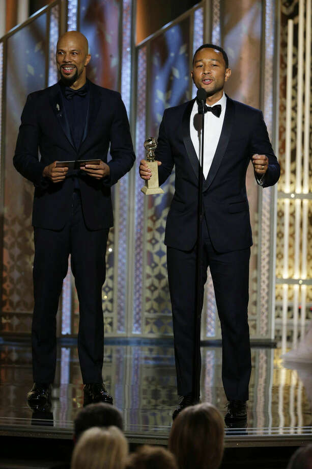 "In this image released by NBC, Common, left, and John Legend accept the award for best original song for ""Glory,"" from the film ""Selma,"" at the 72nd Annual Golden Globe Awards on Sunday, Jan. 11, 2015, at the Beverly Hilton Hotel in Beverly Hills, Calif. (AP Photo/NBC, Paul Drinkwater)"