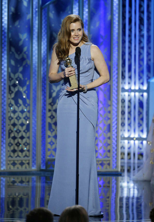 "In this image released by NBC, Amy Adams accepts the award for best actress in a motion picture comedy or musical for her role in ""Big Eyes"" at the 72nd Annual Golden Globe Awards on Sunday, Jan. 11, 2015, at the Beverly Hilton Hotel in Beverly Hills, Calif. (AP Photo/NBC, Paul Drinkwater)"