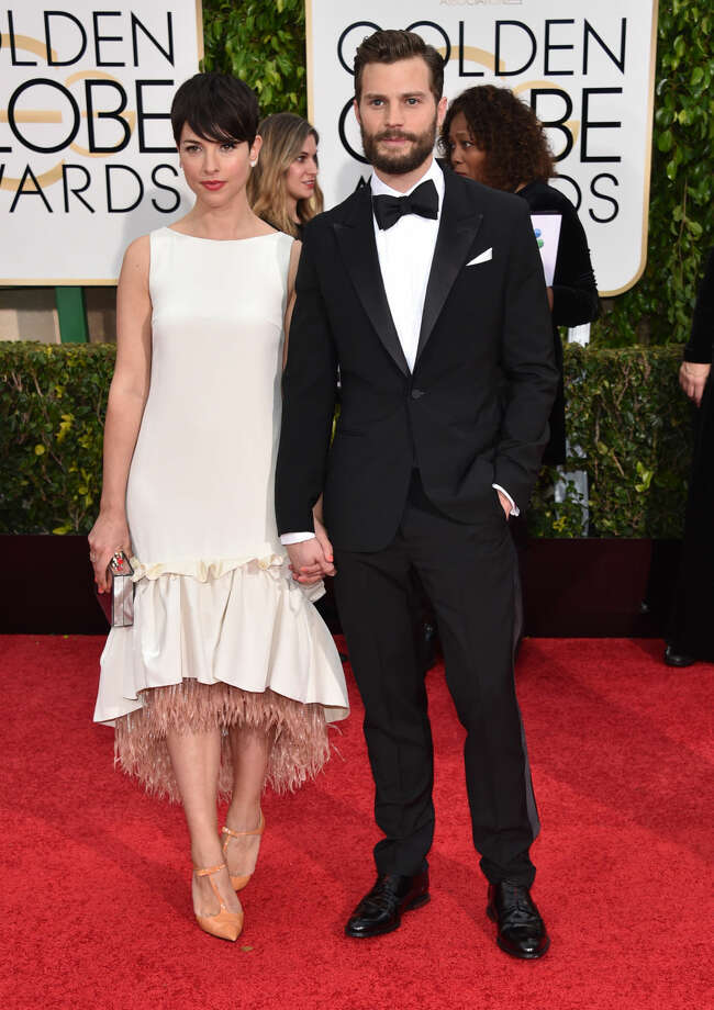 Amelia Warner, left, and Jamie Dornan arrive at the 72nd annual Golden Globe Awards at the Beverly Hilton Hotel on Sunday, Jan. 11, 2015, in Beverly Hills, Calif. (Photo by John Shearer/Invision/AP)