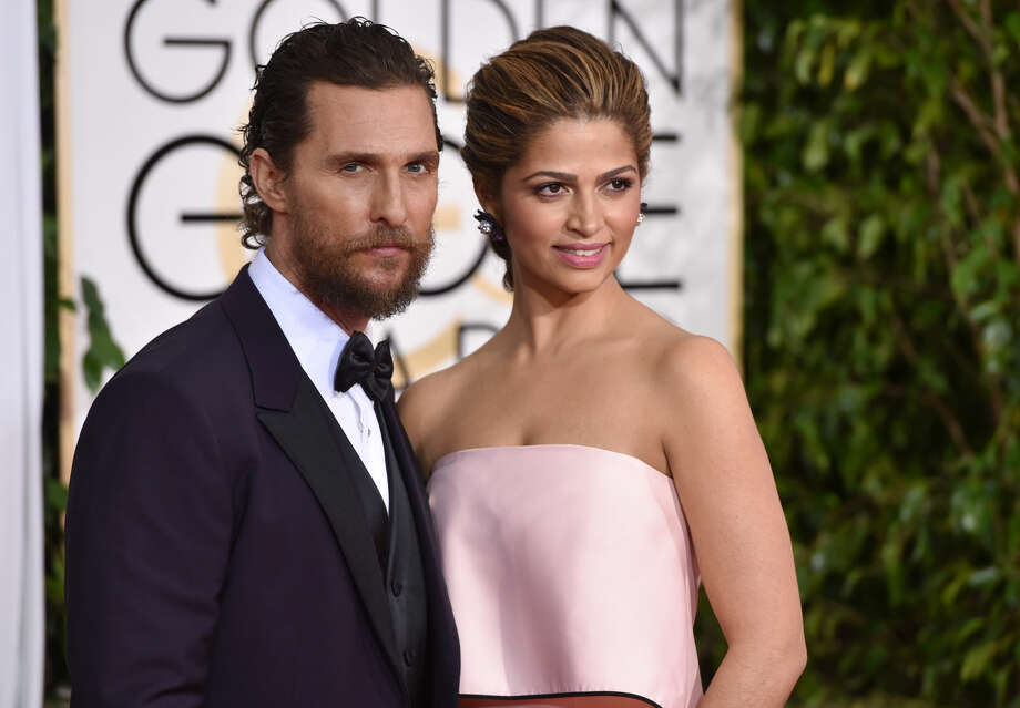 Matthew McConaughey, left, and Camila Alves arrive at the 72nd annual Golden Globe Awards at the Beverly Hilton Hotel on Sunday, Jan. 11, 2015, in Beverly Hills, Calif. (Photo by John Shearer/Invision/AP)