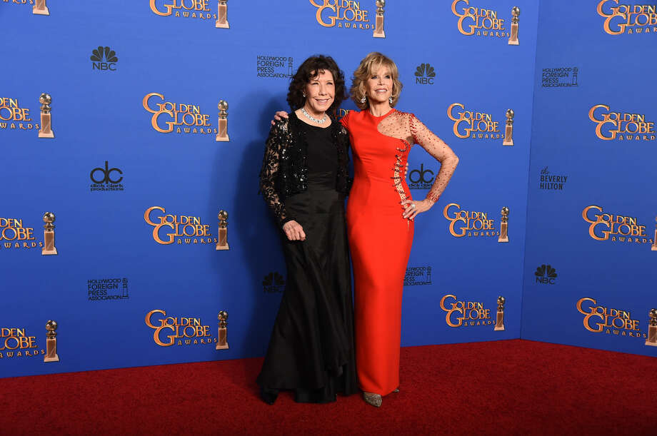 Lily Tomlin, left and Jane Fonda pose in the press room at the 72nd annual Golden Globe Awards at the Beverly Hilton Hotel on Sunday, Jan. 11, 2015, in Beverly Hills, Calif. (Photo by Jordan Strauss/Invision/AP)