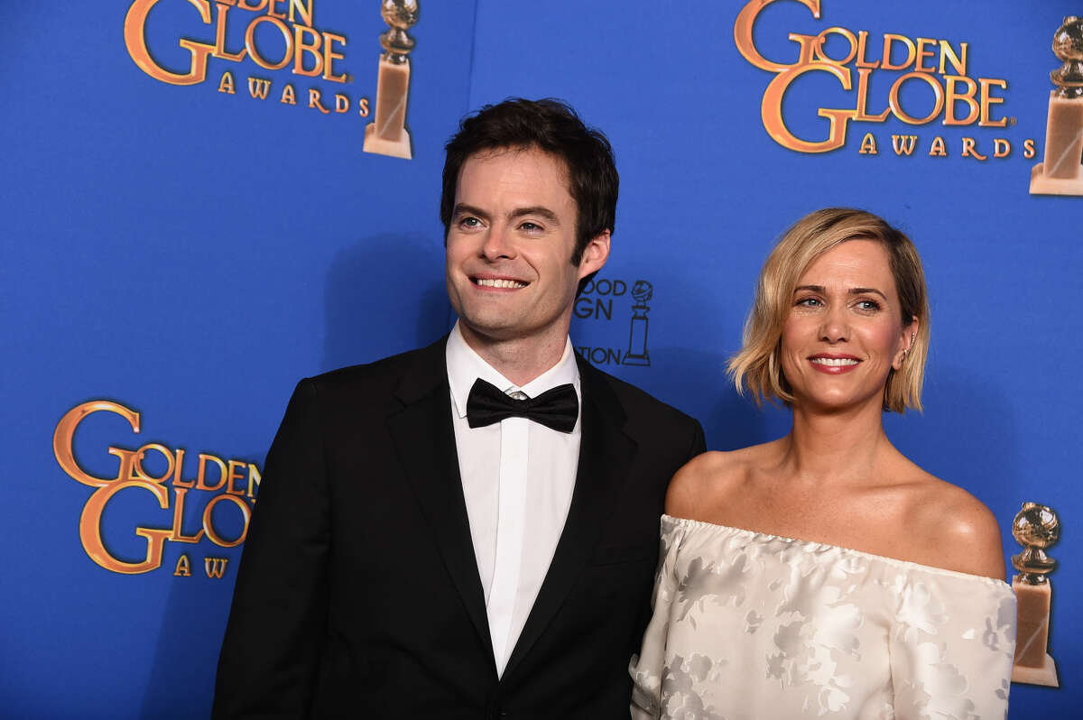 Bill Hader, left, and Kristen Wiig pose in the press room at the 72nd annual Golden Globe Awards at the Beverly Hilton Hotel on Sunday, Jan. 11, 2015, in Beverly Hills, Calif. (Photo by Jordan Strauss/Invision/AP)