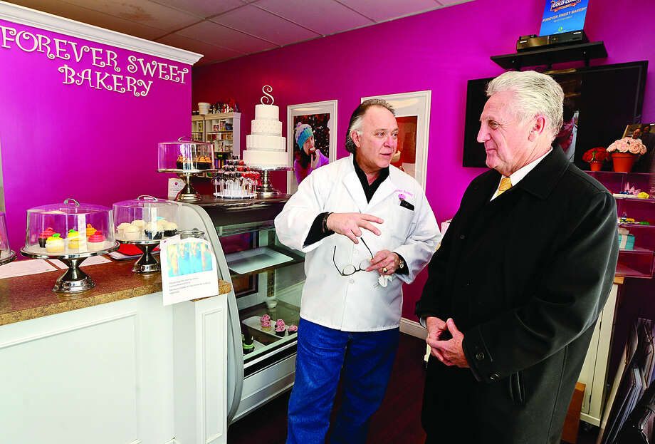 Hour photo / Erik TrautmannForever Sweet Bakery owner Sky Mercede greets Norwalk Mayor Harry Rilling as the mayor visits the shop on New Canaan Ave. Wednesday as part of the his small business initiative.