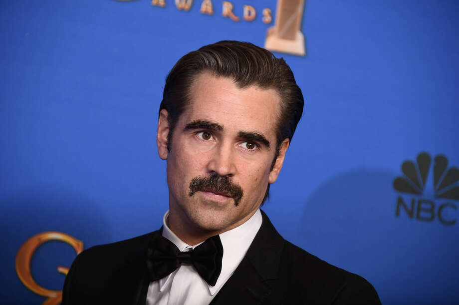 Colin Farrell poses in the press room at the 72nd annual Golden Globe Awards at the Beverly Hilton Hotel on Sunday, Jan. 11, 2015, in Beverly Hills, Calif. (Photo by Jordan Strauss/Invision/AP)