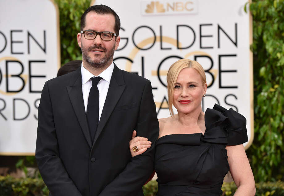 Eric White, left, and Patricia Arquette arrive at the 72nd annual Golden Globe Awards at the Beverly Hilton Hotel on Sunday, Jan. 11, 2015, in Beverly Hills, Calif. (Photo by John Shearer/Invision/AP)