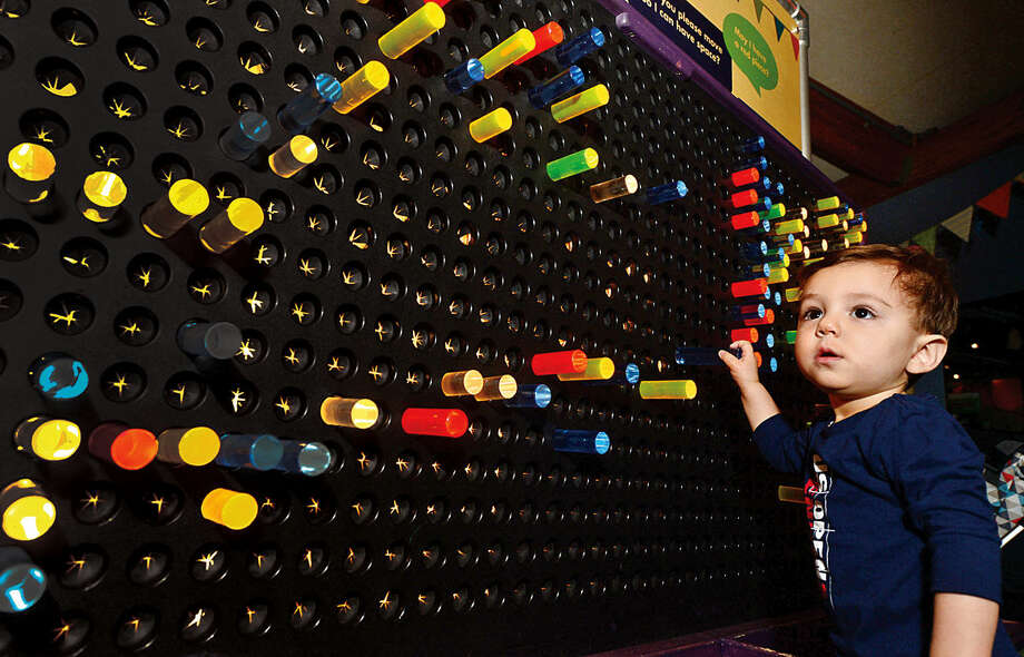 Hour photo / Erik Trautmann Greyson Wu, 18 months, interacts with the exhibits at Stepping Stones Museum for Children Saturday. Stepping Stones will be hosting the Association of Children's Museums InterActivity 2016 conference, Collective Impact, this May.