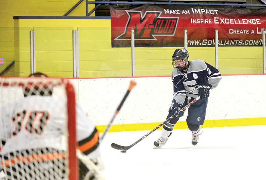 Hour photo / Erik Trautmann #2 for Staples Eric Zurmuehle looks to score during their hockey game against Stamford High at Terry Connors Rink in Stamford Saturday.