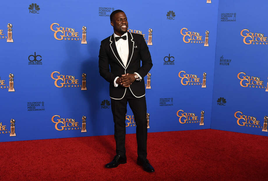 Kevin Hart poses in the press room at the 72nd annual Golden Globe Awards at the Beverly Hilton Hotel on Sunday, Jan. 11, 2015, in Beverly Hills, Calif. (Photo by Jordan Strauss/Invision/AP)