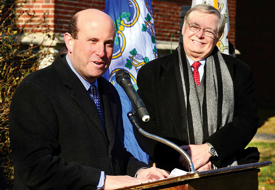 Hour photo / Erik Trautmann Stamford Mayor David Martin is joined by Board of Education president Geoff Alswanger who speaks during the groundbreaking ceremony of a new school at the site of the former Sacred Heart Academy Thursday morning.