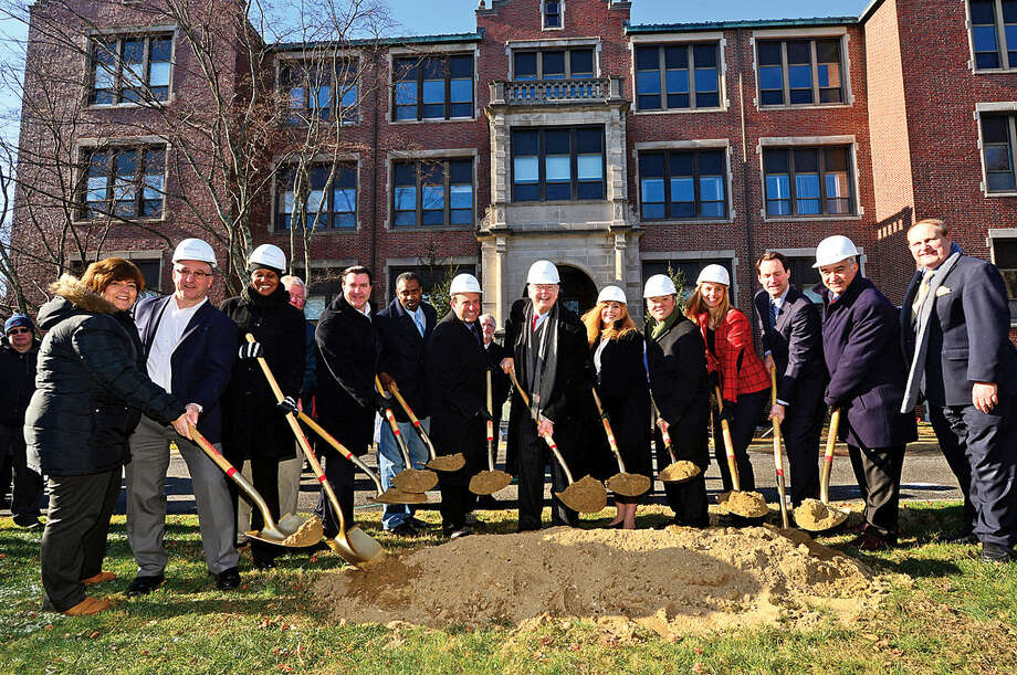 Mayor David Martin, center, is joined by local officials and state representatives for the groundbreaking ceremony of the new school at the site of the former Sacred Heart Academy Thursday morning.