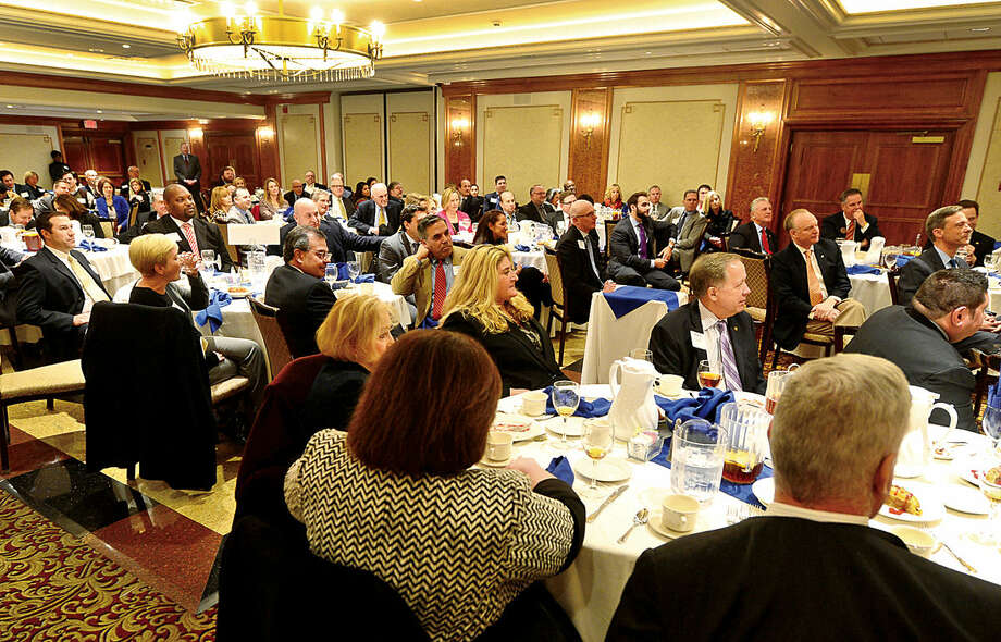 Hour photo / Erik Trautmann Attendees of the Greater Norwalk Chamber of Commerce 2016 Economic Outlook & Development Review Luncheon listen to the keynote address of Dr. Nicholas Perna at the Norwalk Inn Tuesday.