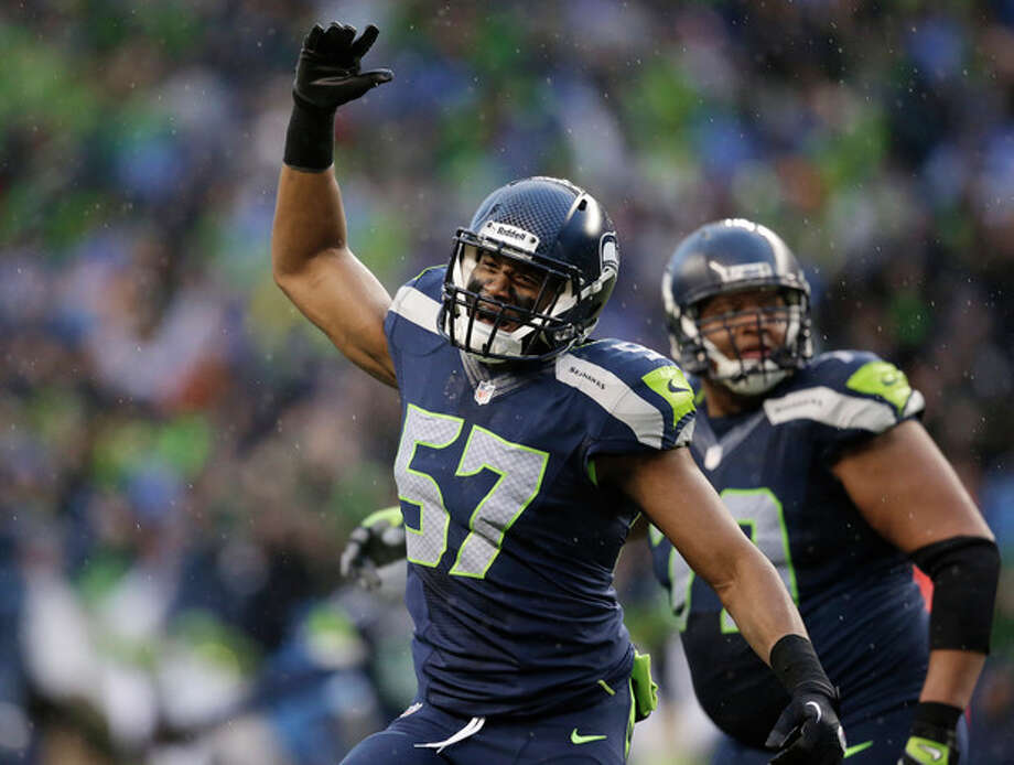 Seattle Seahawks linebacker Mike Morgan (57) celebrates after New Orleans Saints kicker Shayne Graham missed a 48-yard field goal during the fourth quarter of an NFC divisional playoff NFL football game in Seattle, Saturday, Jan. 11, 2014. (AP Photo/Elaine Thompson) / AP