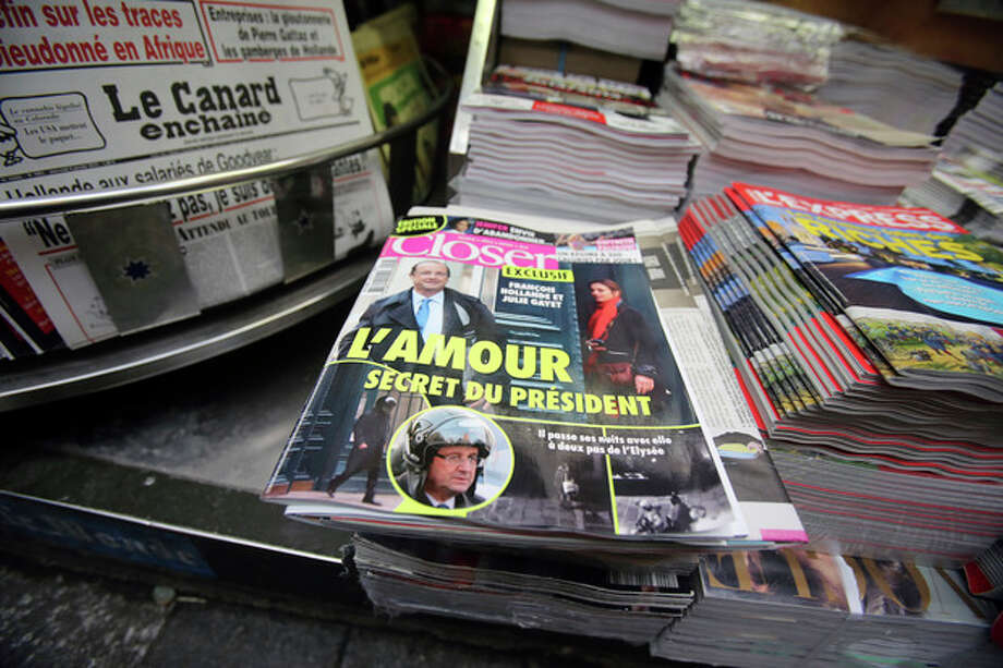 "The French magazine Closer with photos of French President Francois Hollande and French actress Julie Gayet on its front page, is presented in a newspaper stall on the Champs Elysee Avenue in Paris, Friday Jan. 10, 2013. French President Francois Hollande is threatening legal action over the magazine report saying he is having a secret affair with the French actress Julie Gayet. Hollande, in a statement obtained by The Associated Press, says he ""deeply deplores the attacks on respect for privacy, to which each citizen has a right."" .(AP Photo/Remy de la Mauviniere) / AP"