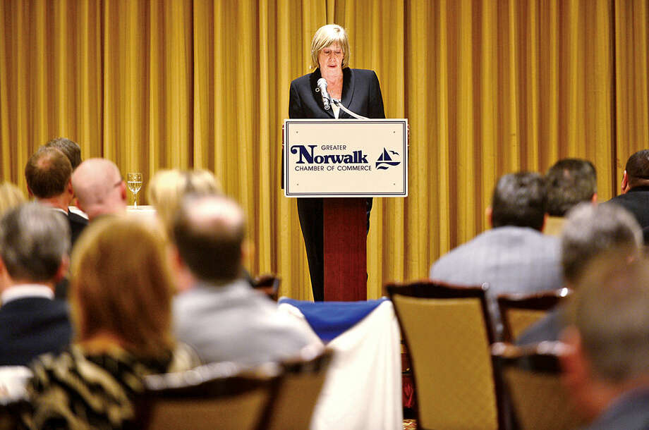 Hour photo / Erik Trautmann Elizabeth Stocker, Norwalk Director of Economic Development, addresses attendees of the Greater Norwalk Chamber of Commerce 2016 Economic Outlook & Development Review Luncheon at the Norwalk Inn Tuesday.