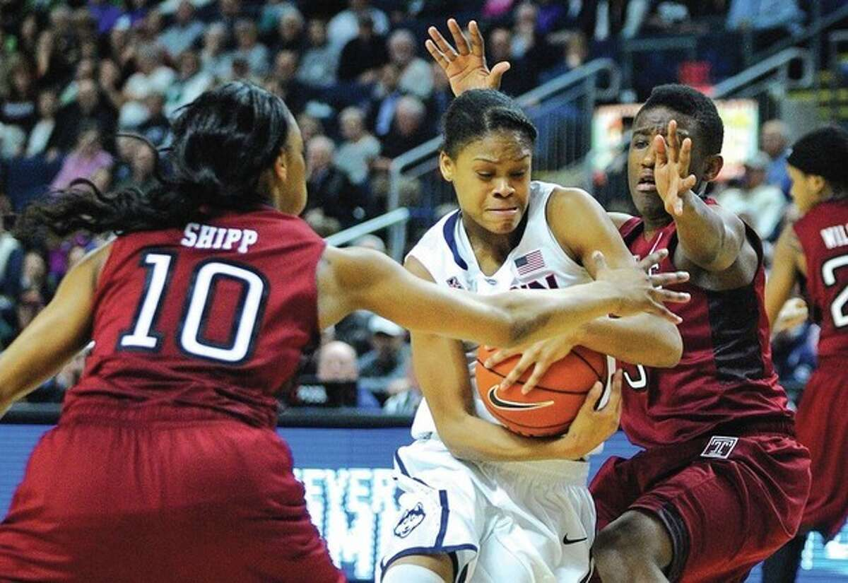 AP photo UConn point guard Moriah Jefferson, center, drives past Temple's Shi-Heria Shipp, left, and Rateska Brown during the second half of Saturday's 80-36 victory by the top-ranked Huskies at Webster Bank Arena in Bridgeport. Jefferson played a key role in the early second-half surge that turned the game into another UConn rout.