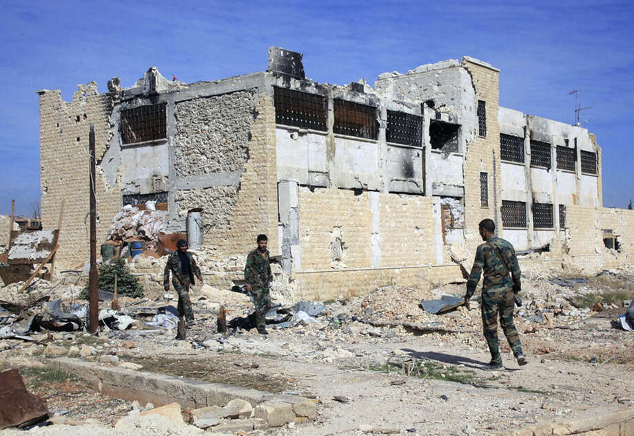 FILE - This Wednesday, Nov. 11, 2015, file photo released by the Syrian official news agency SANA, shows Syrian government troops walk inside the Kweiras air base, east of Aleppo, Syria. Syrian peace talks scheduled to begin in a week are looking increasingly moot as regional tensions boil over and a string of battlefield victories by government troops further bolster the hand of President Bashar Assad, plunging the rebels into disarray. (SANA via AP, File)