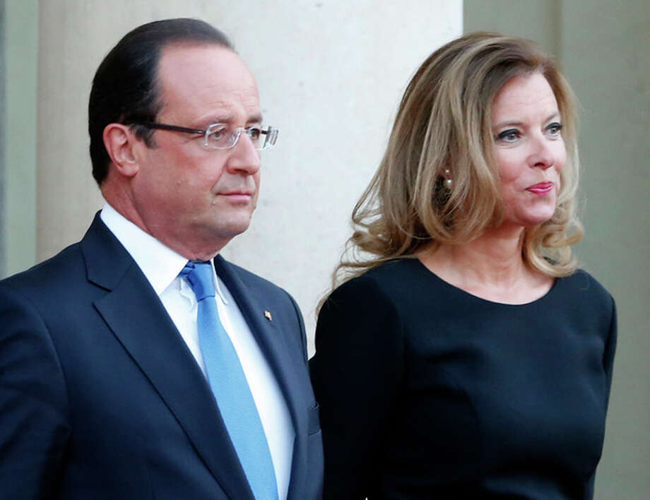 FILE - In this Sept. 3, 2013 file photo, French president Francois Hollande and his companion Valerie Trierweiler wait for German President Joachim Gauckand, at the Elysee Palace, in Paris. The magazine Closer published images Friday Jan. 10, 2014 showing his bodyguard and a helmeted man it says is Hollande visiting what it says is the apartment of the actress. Hollande is threatening legal action over magazine report saying he is having a secret affair with a French actress. (AP Photo/Jacques Brinon, File) / AP