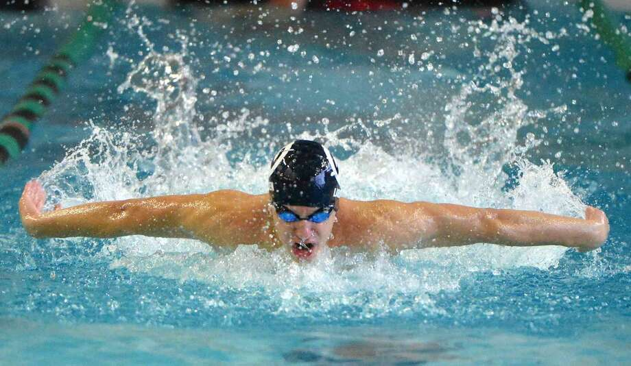 Wilton's Christian Larsen swims the butterfly in the 200 Medley vs Norwalk-McMahon.