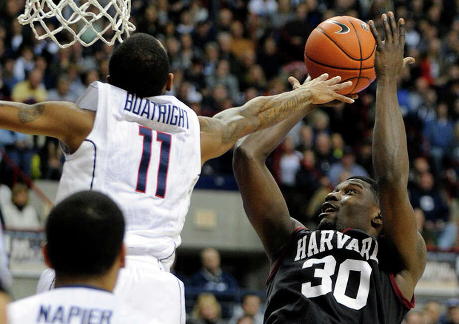 Connecticut's Ryan Boatright (11) guards Harvard's Kyle Casey (30)during the first half of an NCAA college basketball game in Storrs, Conn., Wednesday, Jan. 8, 2014. (AP Photo/Fred Beckham) / FR153656 AP
